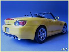 model car(0.0), automobile(1.0), automotive exterior(1.0), wheel(1.0), vehicle(1.0), honda(1.0), honda s2000(1.0), bumper(1.0), land vehicle(1.0), sports car(1.0),