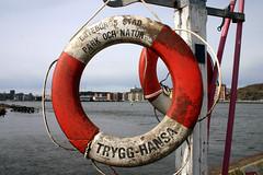 wheel(0.0), personal flotation device(0.0), longship(0.0), viking ships(0.0), sea(1.0), red(1.0), lifebuoy(1.0),