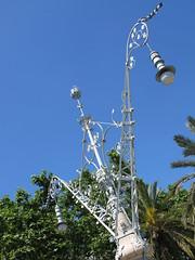 flower(0.0), tower(0.0), lighting(0.0), light fixture(1.0), pole(1.0), wind(1.0), street light(1.0), sky(1.0),