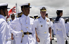 In this file photo, U.S. Pacific Fleet Commander Adm. Patrick Walsh inspects the sailors assigned to the JS Kashima (TV 3508) honor guard detail at Pearl Harbor during the June 2010 visit of the JMSDF Training Squadron. (U.S. Navy photo by Mass Communication Specialist 2nd Class (SW) Mark Logico)