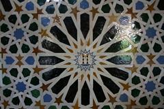 textile(0.0), kaleidoscope(0.0), ceiling(0.0), flooring(0.0), art(1.0), pattern(1.0), mosaic(1.0), symmetry(1.0), design(1.0), circle(1.0), blue(1.0),