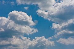 White clouds on a bright blue summer sky