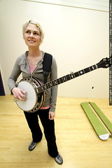 rachel playing banjo in the remodeled office