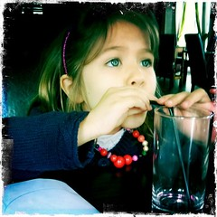 a girl drinking with a straw