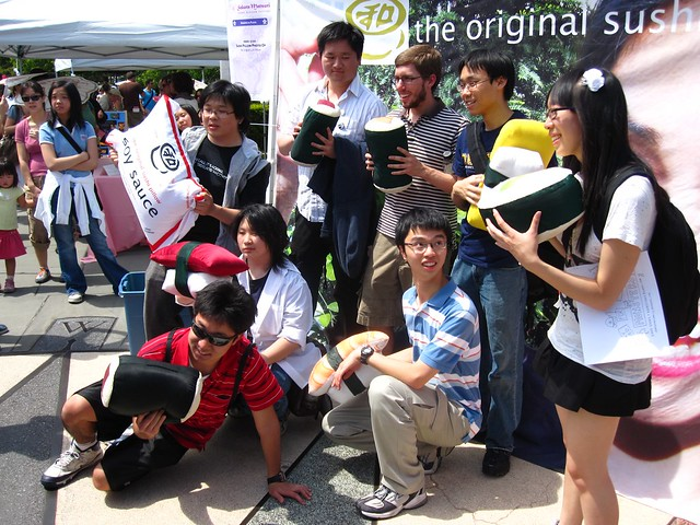 Visitors pose with the original sushi pillow at Sakura Matsuri 2010.