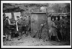 Artillerymen outside dugouts