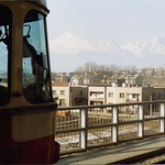 Poprad stanica . Electric tram and tatra mountains. March 1993