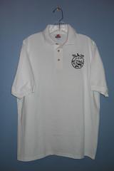 long-sleeved t-shirt(0.0), pocket(0.0), clothing(1.0), collar(1.0), white(1.0), sleeve(1.0), polo shirt(1.0), t-shirt(1.0),
