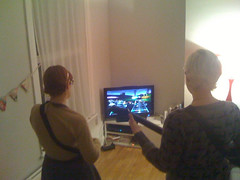 Fiona and Becky playing guitar hero