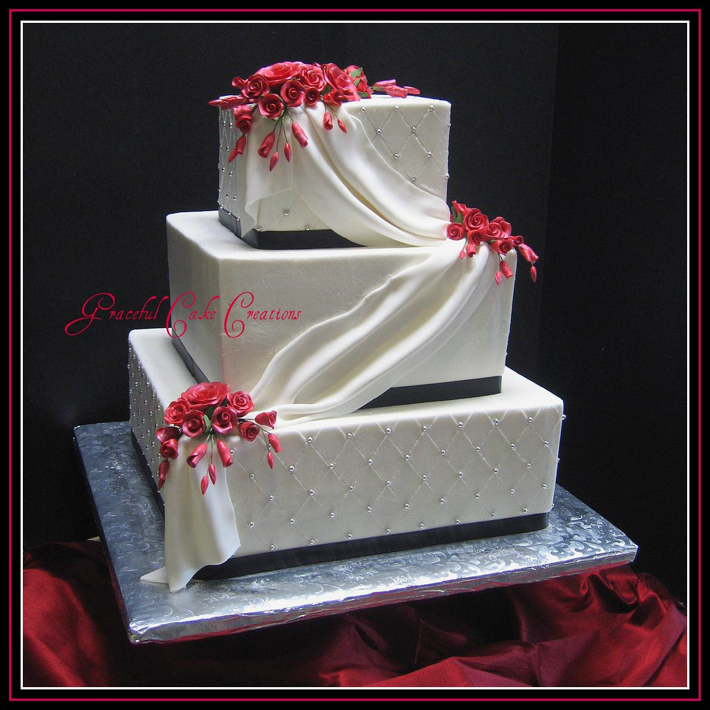 Square Black and White Wedding Cake with Red Roses a