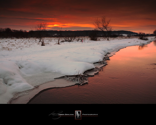 winter sunset sky orange snow ice nature water wisconsin river landscape photography photo midwest stream december image picture bank newyear explore madison ripples 2009 canonef1740mmf4lusm canoneos5d flickrexplore flickrfrontpage ninesprings lorenzemlicka
