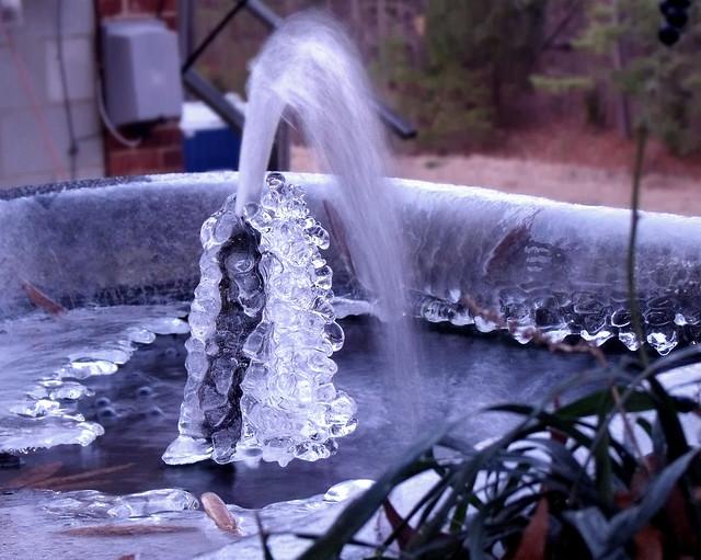 Frozen koi pond flickr photo sharing for Premade koi ponds