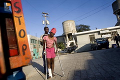 Haiti Woman on Crutches After Quake