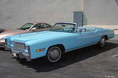 cadillac calais(0.0), full-size car(0.0), automobile(1.0), automotive exterior(1.0), cadillac(1.0), vehicle(1.0), cadillac eldorado(1.0), sedan(1.0), classic car(1.0), land vehicle(1.0), luxury vehicle(1.0), coupã©(1.0), convertible(1.0),