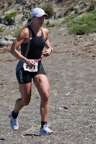 Amity Hall running in the Inaugural Morro Bay Triathlon 06 June 2010, swim, bike, beach run.