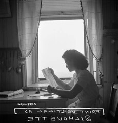 Female employee of Dominion Arsenals Ltd. writing letter, Québec, Canada, Que. / Une employée de l'usine Dominion Arsenals Ltd. écrivant une lettre. Québec, Canada (Québec, Canada)