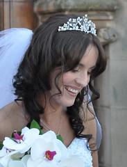veil(0.0), bride(1.0), bridal veil(1.0), hairstyle(1.0), flower(1.0), clothing(1.0), wedding(1.0), woman(1.0), female(1.0), headpiece(1.0), beauty(1.0), headgear(1.0),