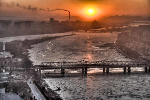 bridge sunset chimney river frozen kim smoke korea stack il communism kimjongil northkorea jong pyongyang taedong chinanorthkoreajanuary2010 chinanorthkoreajanuary2010hdr