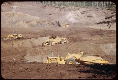 mud(0.0), soil(1.0), vehicle(1.0), construction equipment(1.0), quarry(1.0),