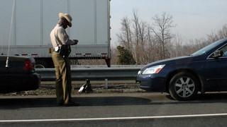 Police trooper writing a ticket