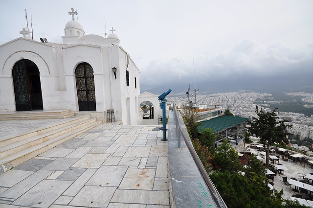 St George church at the top of Mount Lycabettus and Athens on the background