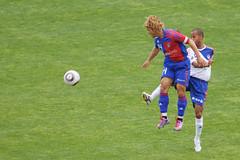 australian rules football(0.0), competition event(0.0), women's football(0.0), football player(1.0), ball(1.0), soccer kick(1.0), kick(1.0), play(1.0), sports(1.0), team sport(1.0), tackle(1.0), player(1.0), football(1.0), ball game(1.0), stadium(1.0), ball(1.0), tournament(1.0),