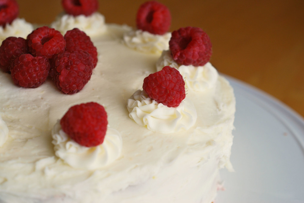 Lemon Poppy Seed Cake with Raspberry Curd - light and fluffy lemon poppy seed cake with a homemade raspberry curd layer and a lemon buttercream.