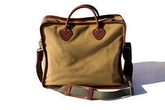 brand(0.0), bag(1.0), shoulder bag(1.0), brown(1.0), handbag(1.0), hand luggage(1.0), messenger bag(1.0), maroon(1.0), leather(1.0), baggage(1.0),