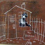 Banksy in Boston: Overview of the NO LOITRIN piece on Essex St in Central Square, Cambridge