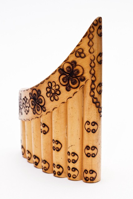 Brown pan flute standing upright