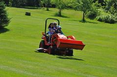 field(0.0), soil(0.0), outdoor power equipment(1.0), grass(1.0), vehicle(1.0), mower(1.0), lawn mower(1.0), lawn(1.0), grassland(1.0),
