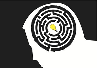 Head in a labyrinth with light bulb