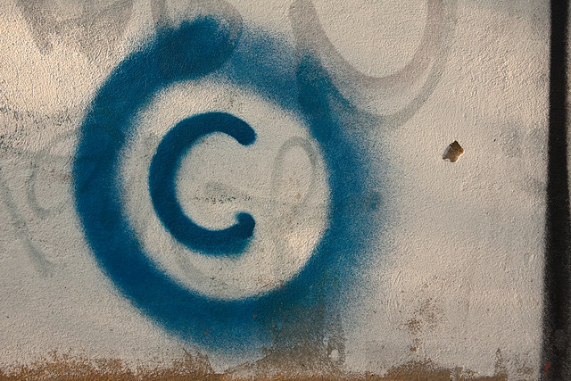 Large copyright graffiti sign on cream colored wall from Flickr via Wylio