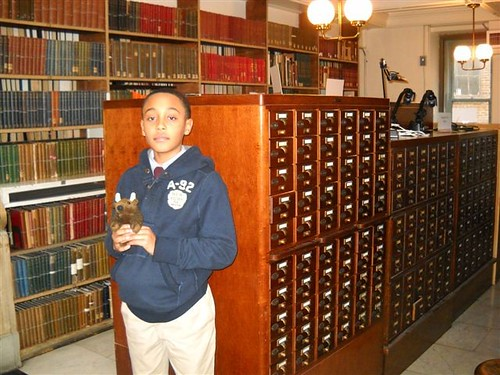 Buddy Bison and friend researching at the card catalog at Baltimore's Peabody Library