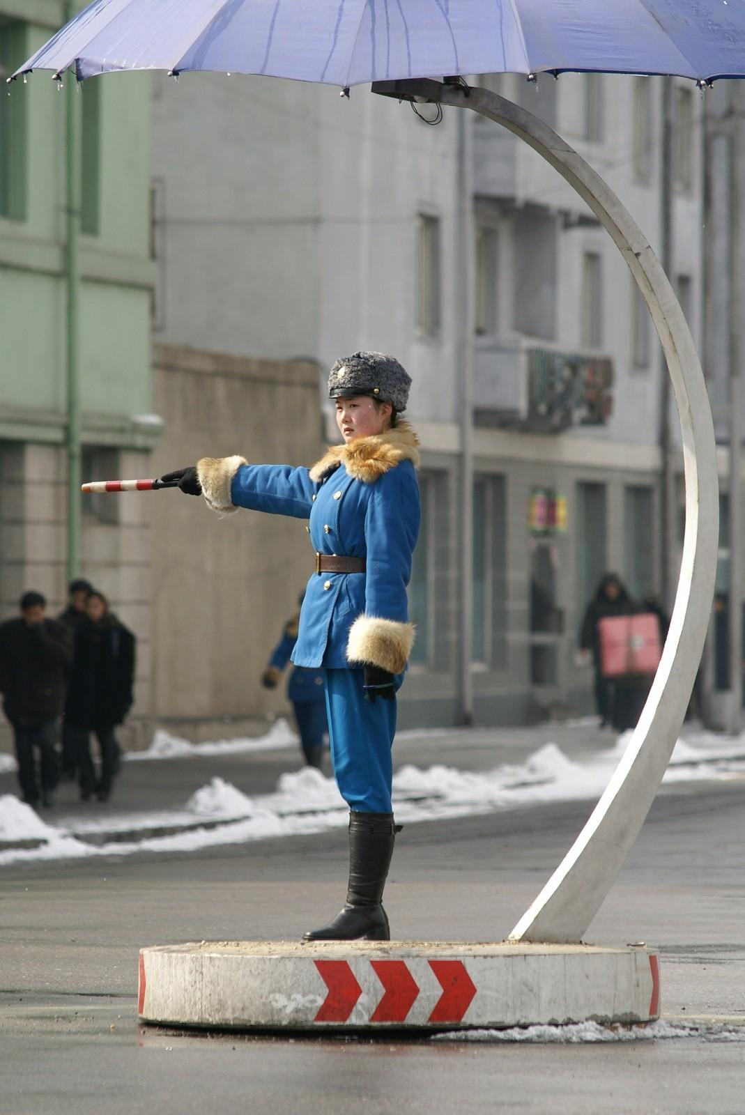 Traffic policewoman near Taedong Bridge, Pyongyang