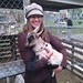 <p>Michigan Agritours managing partner Gillian with a baby goat.</p>
