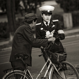 Trafic officer and biker - Pyongyang North Korea