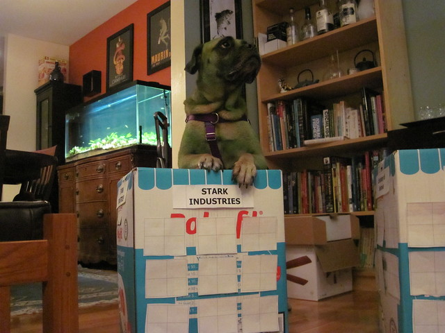 The InGretable Hulk on top of a box with the sign Stark Industries on it.