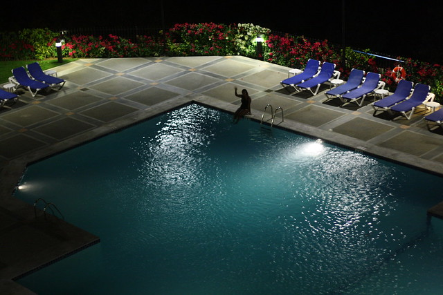 A swimming pool at night, as seen from above, at our hotel in Managua