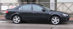 subcompact car(0.0), automobile(1.0), automotive exterior(1.0), wheel(1.0), vehicle(1.0), hyundai sonata(1.0), mid-size car(1.0), compact car(1.0), bumper(1.0), sedan(1.0), land vehicle(1.0),
