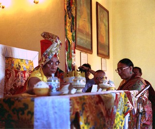 HH Sakya Trizin, (on the right), offering the mandala of the universe, accepted by HH Dagchen Rinpoche (on the throne) at Sakya College, Rajapur, Uttar Pradesh, India, in 1993