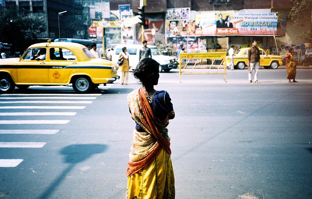 Kolkata : Lady waiting to cross the road