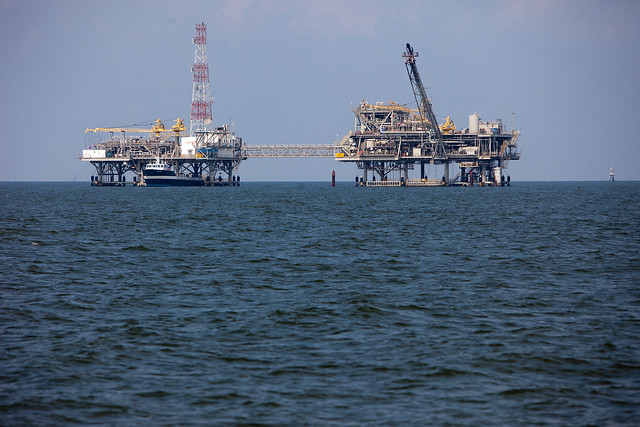 photo of ocean drilling platforms