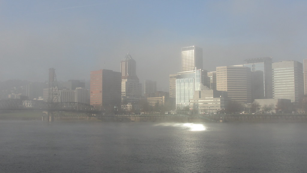 Fog Lifting over downtown Portland as viewed from across the river