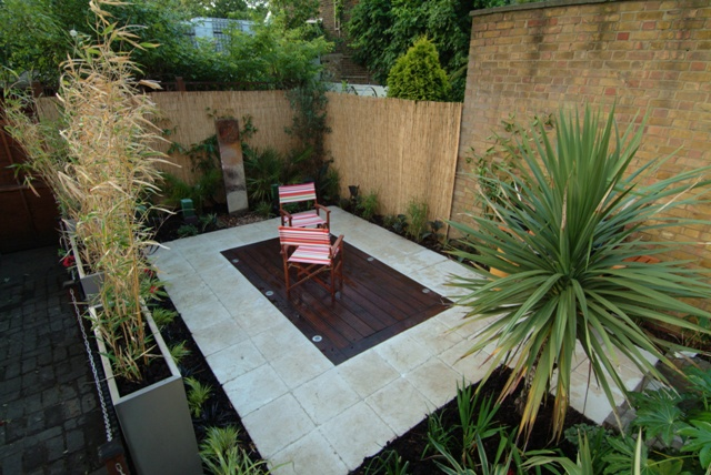 The low maintenance courtyard garden garden by earth for Earth designs landscaping
