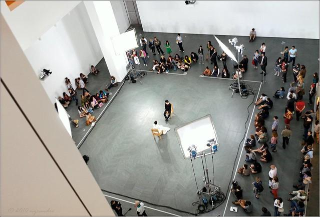 Marina Abramovic present-ing at the MoMA