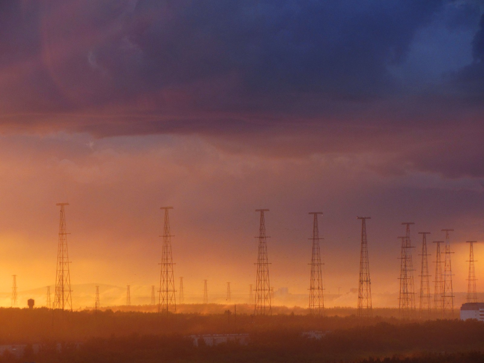 hazy sunset landscape with antennas