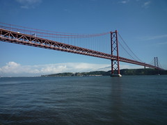 Bridge: 25th of April Type: Suspension bridge Traffic: 6 lanes road, 2 rail tracks inside the deck River: Tagus Location: Lisbon, Portugal