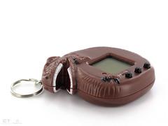 hand(0.0), goggles(0.0), brown(1.0), keychain(1.0),