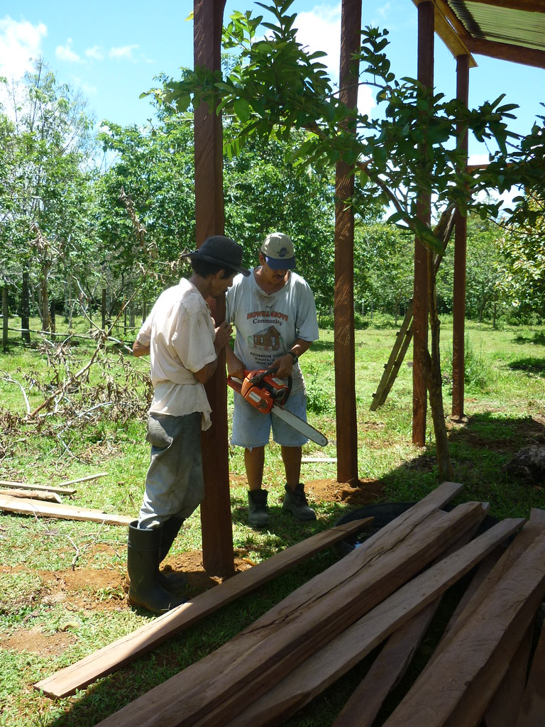 Farmer Rafael Monge, future owner of this livestock corral, and a neighbor cutting lumber for the enclosure.   Read 'Panthera's Guide to Building a Livestock Corral' from our October 2010 newsletter at www.panthera.org/november-2010-newsletter.  Learn more about the work Panthera's Costa Rica team is doing at pantheracostarica.org/.   Also read about our jaguar conservation work in other countries through our Jaguar Corridor Initiative - www.panthera.org/programs/jaguar/jaguar-corridor-initiative - and Pantanal Jaguar Project - www.panthera.org/programs/jaguar/pantanal-jaguar-project.    © Daniel Corrales/Panthera